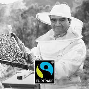 Fairtrade Imker mit Rähmchen und Fairtrade Logo