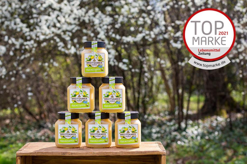 Honiggläser auf einem Tisch gestapelt mit Logo Top Marke 2021